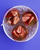 Three glasses of strawberry punch on ice
