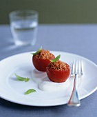 Tomato granita in hollowed-out tomatoes on goat's cheese foam