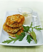 Three small fish cakes with dip