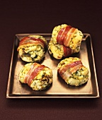 Baked bacon-wrapped potato and Brussels sprout parcels