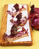 Feta cheese and onion chutney on bread