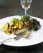 Fish cake with herbs and fruity salsa
