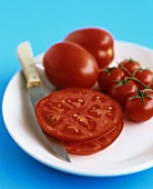 Plum tomatoes, cherry tomatoes and two slices of beefsteak tomato