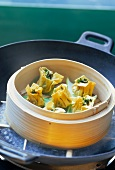 Steamed wontons with spinach filling in steaming basket