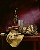 Still life with oysters, dish of pomegranate seeds and jug