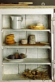 Various foods in food cupboard
