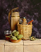 Wine in demijohn, wooden tankard and artichokes on wall