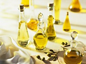 Various plant oils in bottles and carafes