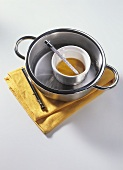 Warming almond oil in bain-marie (for massage)