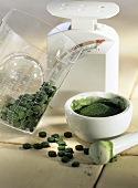 Crushing Chlorella tablets to powder in a mortar