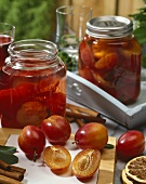 Victoria plums in preserving jars