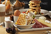 Breakfast: waffles, cold cuts, egg, baked goods etc.