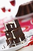 Three pieces of chocolate cake with custard