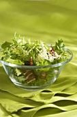Mesclun (mixed salad leaves) in a glass bowl
