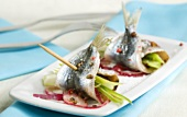 Marinated, filled sardine rolls