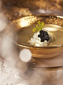 Lentil cream soup with cream and black caviar
