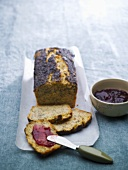 Potato poppy seed bread, one slice spread with jam