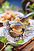 Spicy meat patties with onions in foil