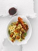 Ribbon pasta with baked garlic and Parma ham