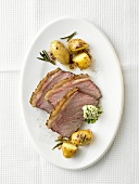 Rump steak with herb butter and rosemary potatoes