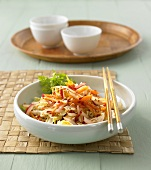 Chinese cabbage, carrot and radish salad with sesame seeds