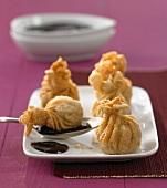 Deep-fried dumplings with plum sauce