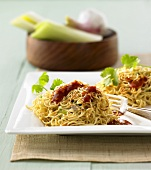 Asian noodle nests with chicken and orange ginger sauce