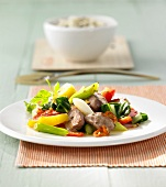 Stir-fried strips of duck with vegetables and pineapple