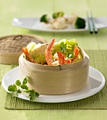 Steamed prawns and Chinese cabbage in steaming basket