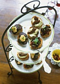 Canapés with black pudding, with stockfish and with olives