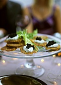 Small potato pancakes with caviar and dill cream
