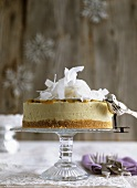 White chocolate cheesecake with coconut & passion fruit sauce