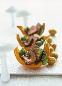 Rump steak with pesto on pumpkin wedges with caramel potatoes