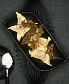 Beetroot ravioli with braised duck ragout
