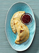 Potato pierogi with cranberry sauce