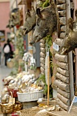 Food shops in a street in Norcia (Italy)