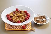Caramelised noodles with raspberries and cinnamon sugar