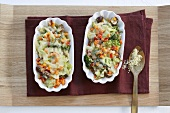 Mixed vegetable gratin in two dishes