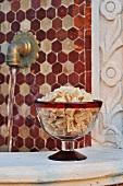 Crystallised ginger in a glass pedestal bowl