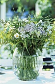 Table decoration of freshly picked flowers and grasses