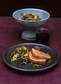 Wok-smoked goose breast on lentil salad