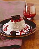Gingerbread parfait with pomegranate cream sauce