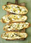 Pizza flatbreads topped with potato, rosemary & sheep's cheese