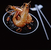 Steamed tiger prawns on black noodles