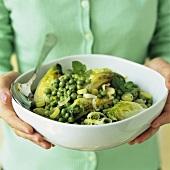 Braised lettuce hearts with peas, leeks and mint
