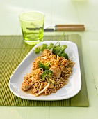 Thai-style fried noodles with chicken and broccoli