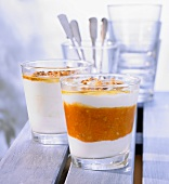 Yoghurt and apricot cream with almonds in glasses