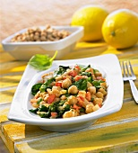Warm chick-pea, spinach and tomato salad