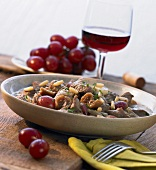 Lamb stew with red grapes, figs and honey