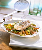 Redfish fillet with saffron butter and steamed vegetables